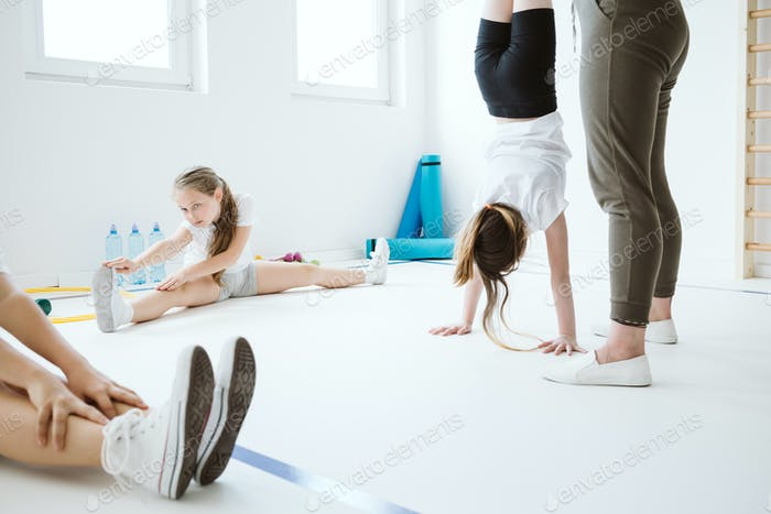 Kids exercising during physical education at school gym