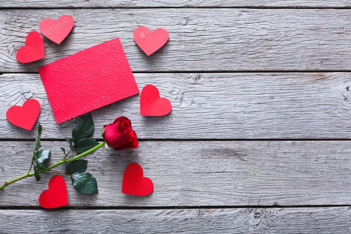Valentine day background, hearts, card and rose flower on wood