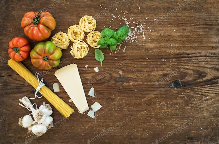 Spaghetti, tagliatelle, garlic, Parmesan cheese, tomatoes and fresh basil