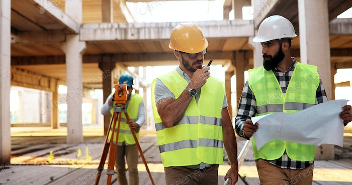 Architect consult engineer on construction site