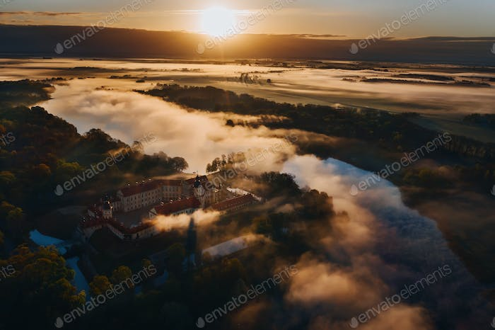 Foggy dawn in Nesvizh.View from the height of the Nesvizh castle and Park at dawn.Misty dawn