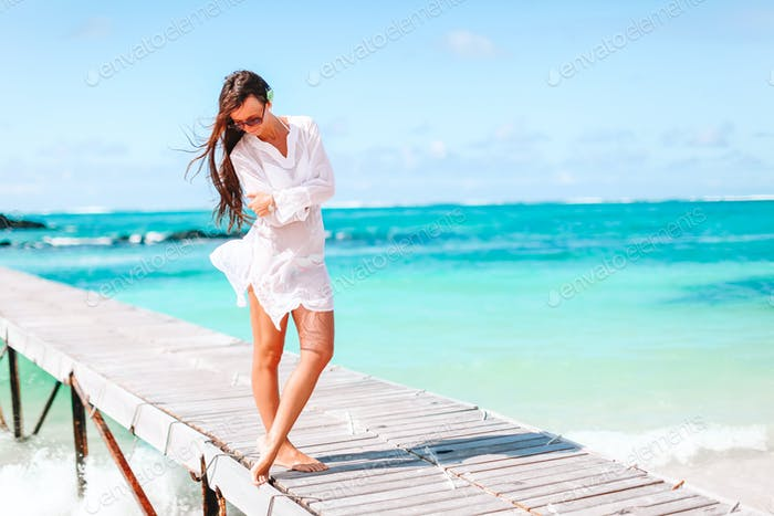 Woman on the beach enjoying summer holidays