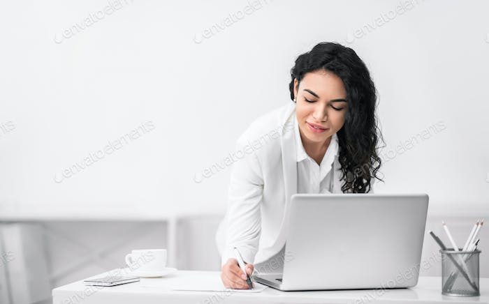Brazilian woman taking some notes and ideas