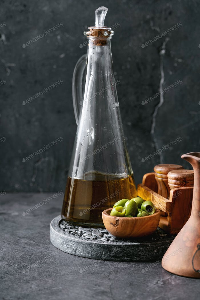 Green olives in wooden bowl