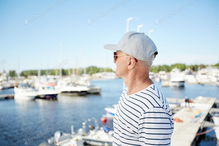 Mature man on vacation in yacht club
