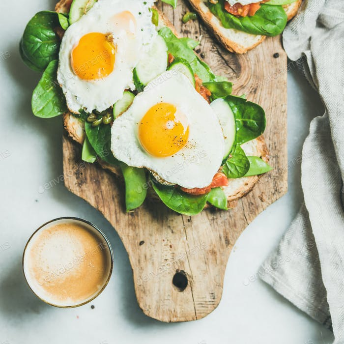 Healthy breakfast sandwiches and cup of coffee, square crop