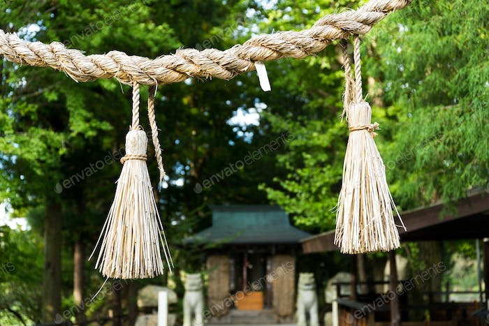 Shinto symbol rope from rice straw in temple
