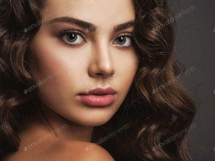 Closeup face of a beautiful woman with a smoky eye makeup