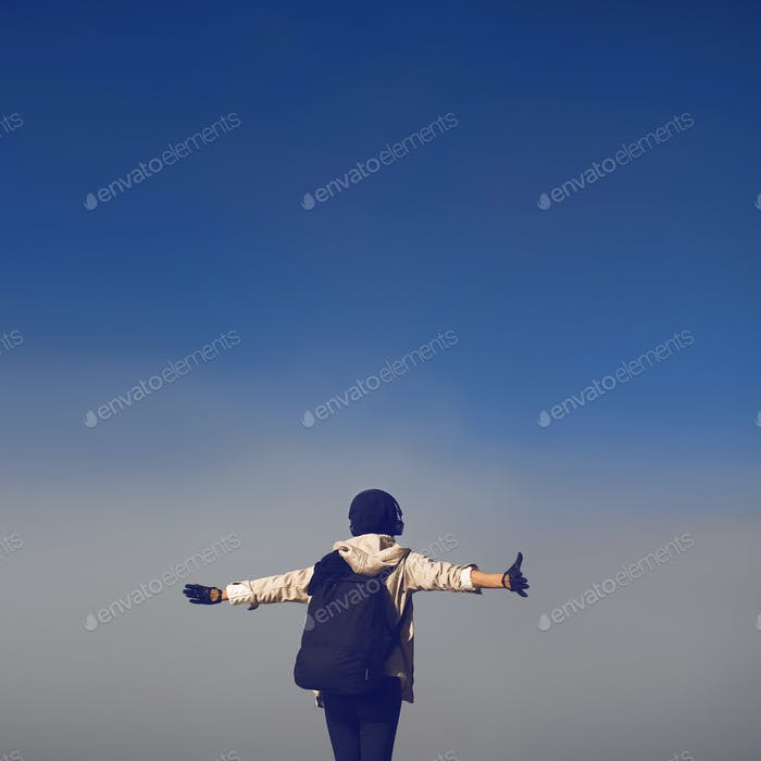 Lifestyle photo. girl tourist in thick fog greets morning hike.