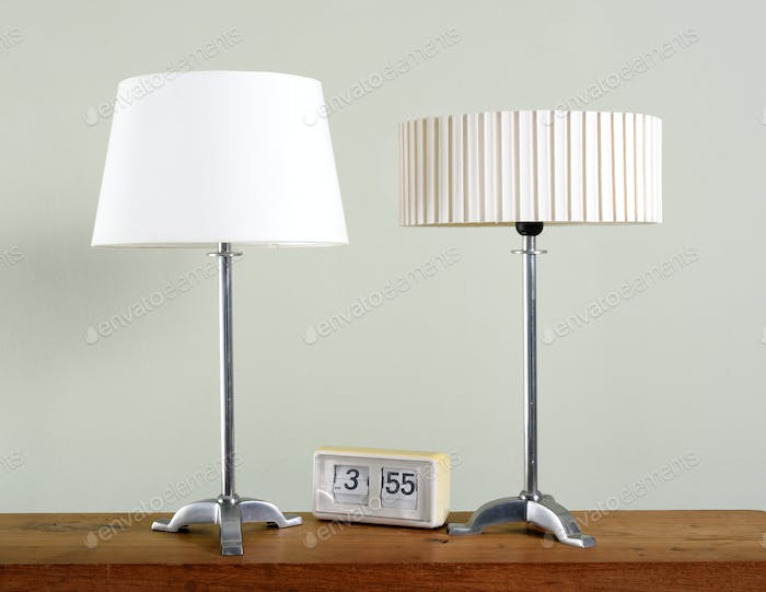 Two vintage metal lamps with white shades
