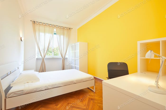 Bedroom for rent in renovated apartment with yellow wall