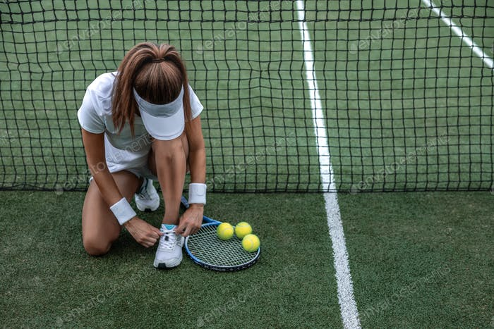 Young tennis player on the court