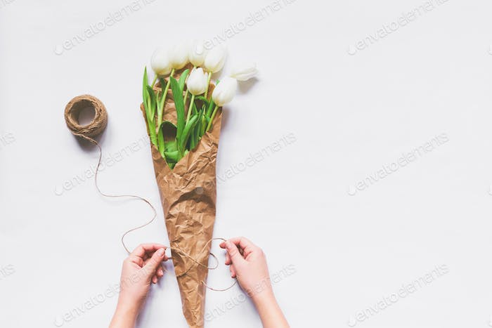 Woman making bouquet of tulips