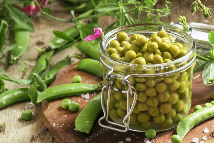 Canned sweet peas in a glass jar, fresh peas