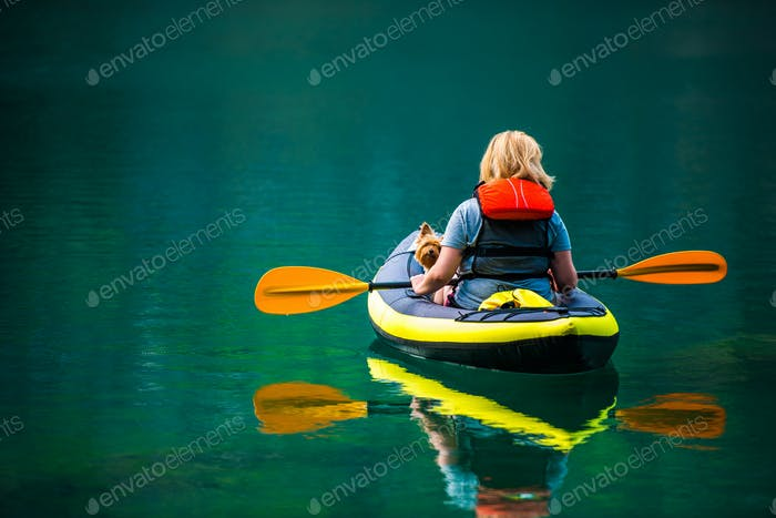Woman with Her Dog in Kayak During Summer Day