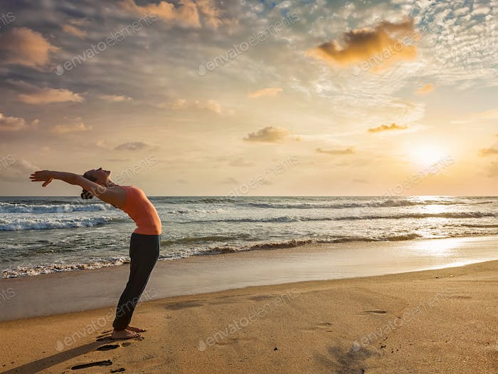 Woman doing yoga Sun salutation Surya Namaskar