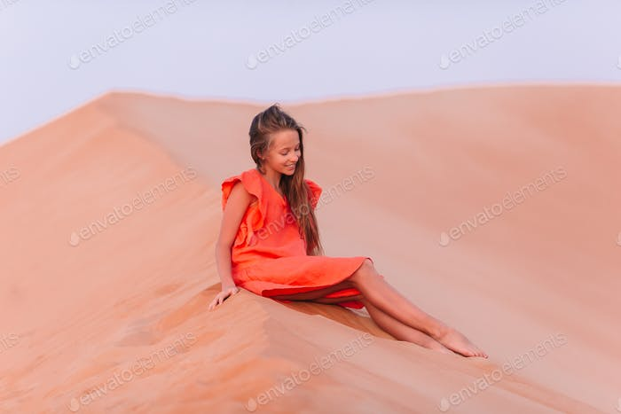 Girl among dunes in Rub al-Khali desert in United Arab Emirates