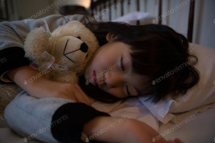 Innocent girl sleeping on bed