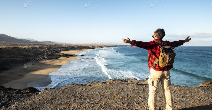 Standing man enjoying the travel and nature landscape