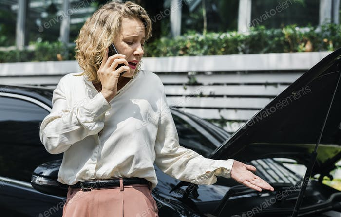 Tensed woman on call about her car