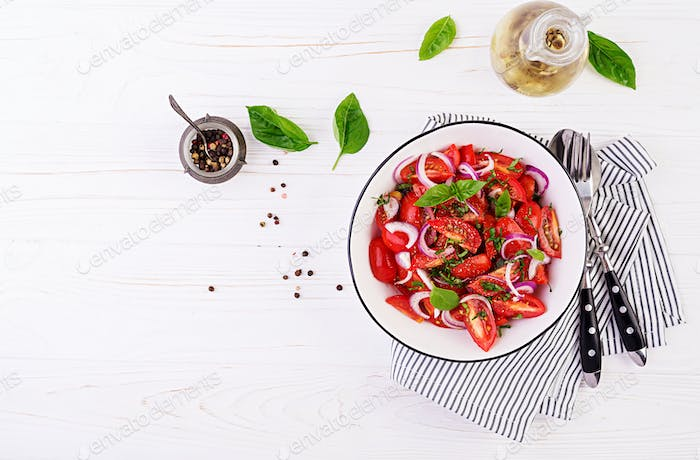 Tomato salad with basil and red onions. Homemade food.  Concept healthy meal