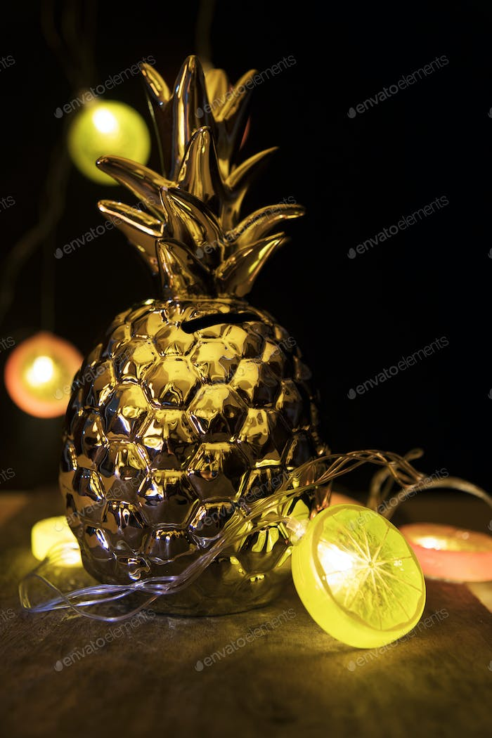 Golden pineaplle and shiny lights
