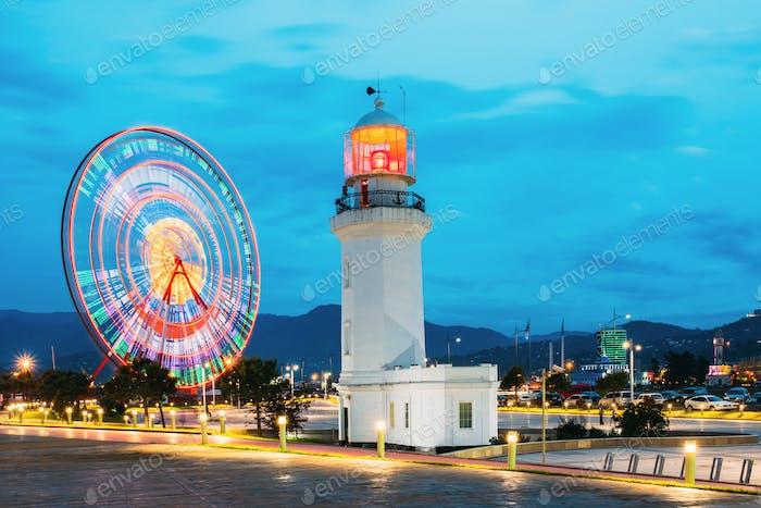 Batumi, Adjara, Georgia. Ferris Wheel In Motion And Pitsunda Lig
