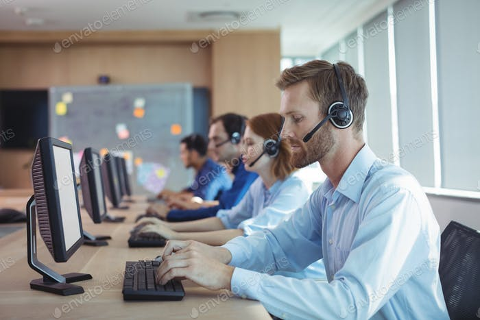 Businessman typing on keyboard at call center