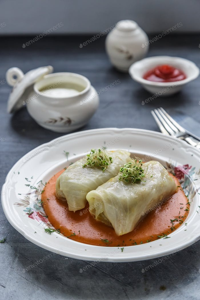 Stuffed cabbage rolls Hungarian cuisine on a white plate.