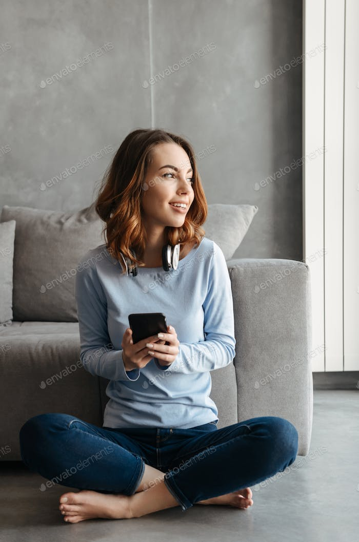 Portrait of a happy young woman using mobile phone