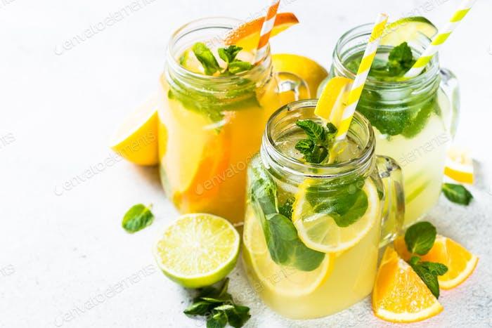 Lemonade, mojito and orange lemonade on white