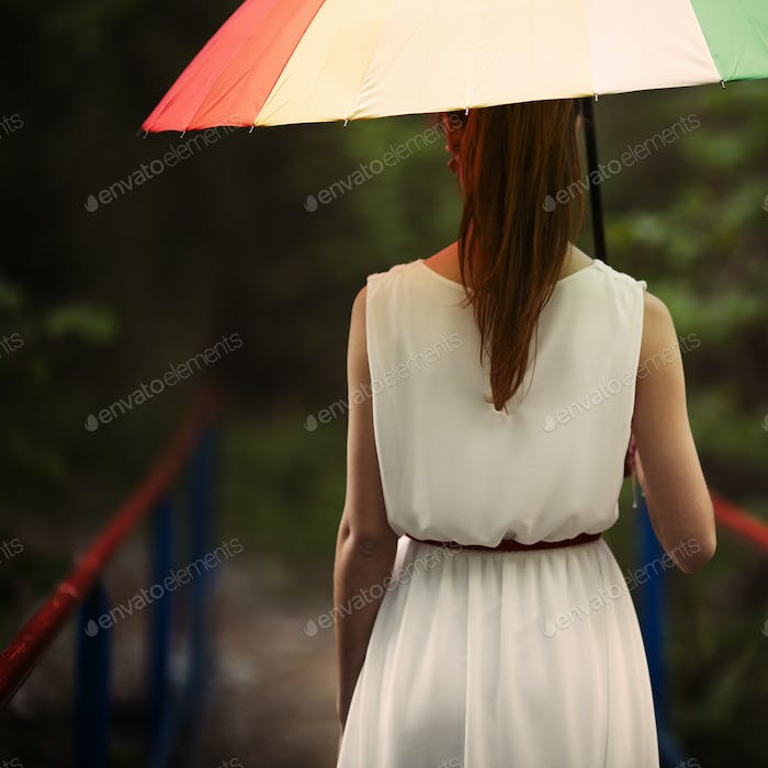 girl portrait with colorful umbrella