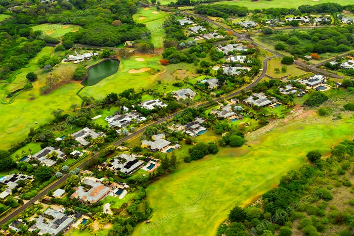 A bird's-eye view of the town and Golf courses on the island of Mauritius.Villas on the island