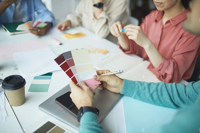Designer holding colored palette