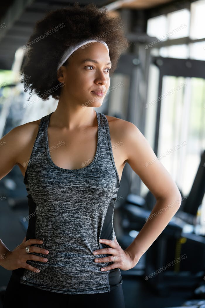 Portrait of young african fitness woman in gym