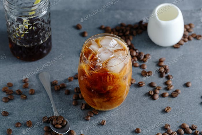 Iced coffee with ice cubes in glass