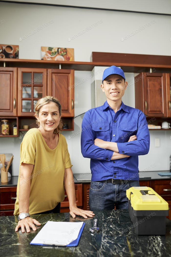 Smiling housewife and repairman