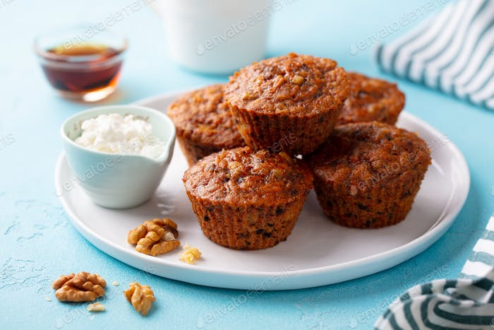 Healthy Vegan Carrot Muffins with Riccota Cheese on a Plate. Blue Stone Background. Close up.