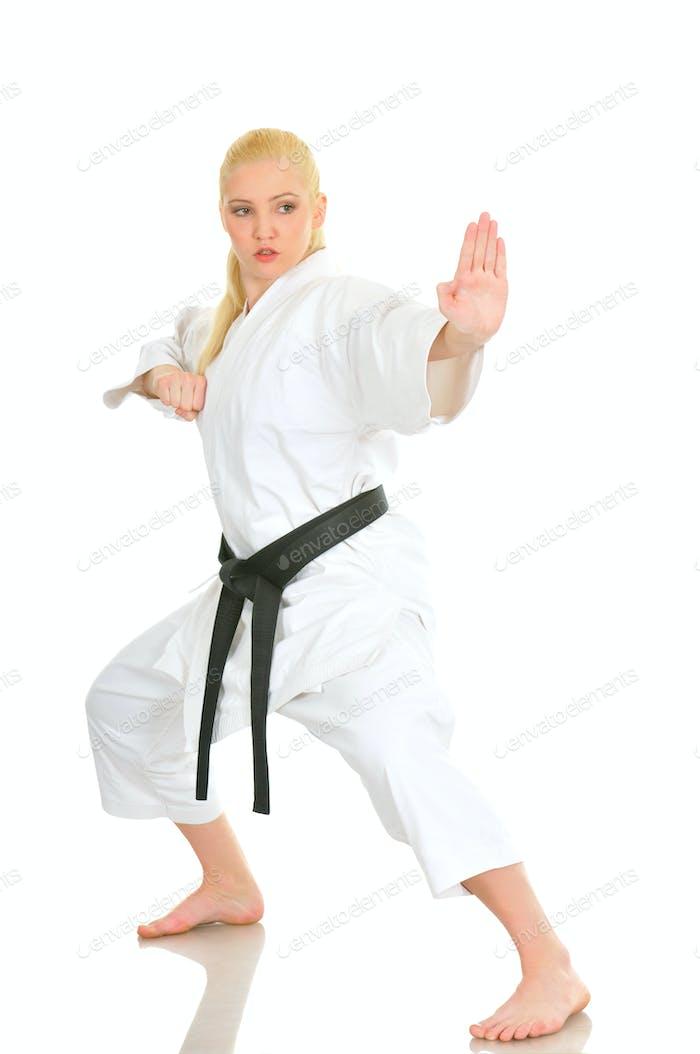 Girl blonde karate sportswoman in a kimono