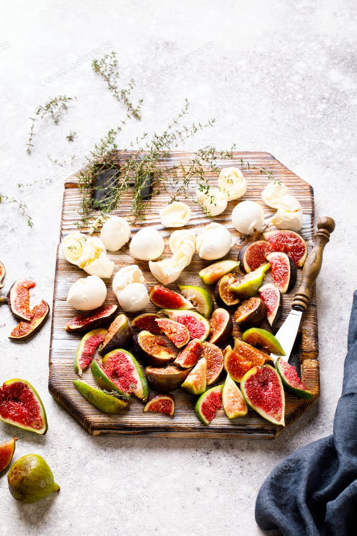 Ingredients for Salad Preparation. Figs Mozzarella Thyme and honey
