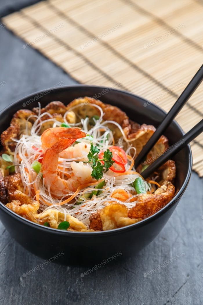 Thai omelette with noodles and shrimps, copy space