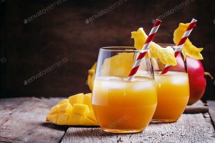 Freshly squeezed mango juice with ice and straws