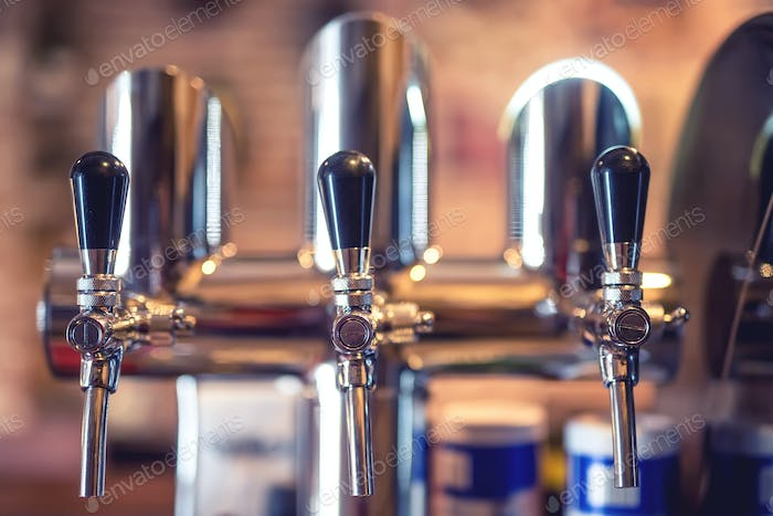 Beer tap at restaurant, bar or pub. Close-up details of beer dra