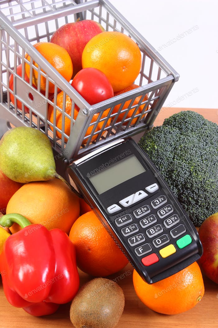Credit card reader with fruits and vegetables, cashless paying for shopping