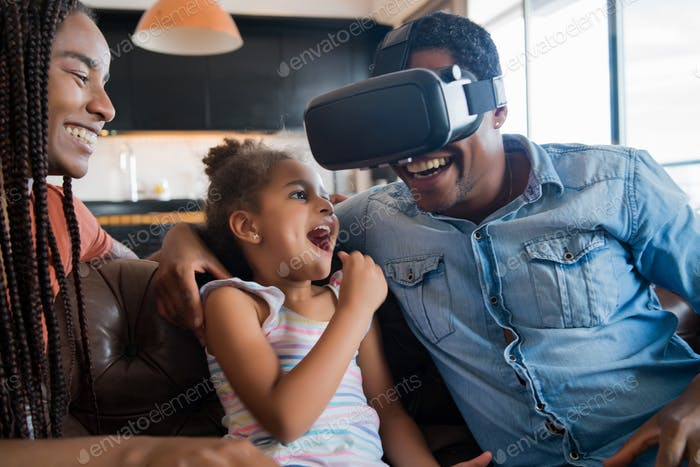 Family playing video games with VR glasses.