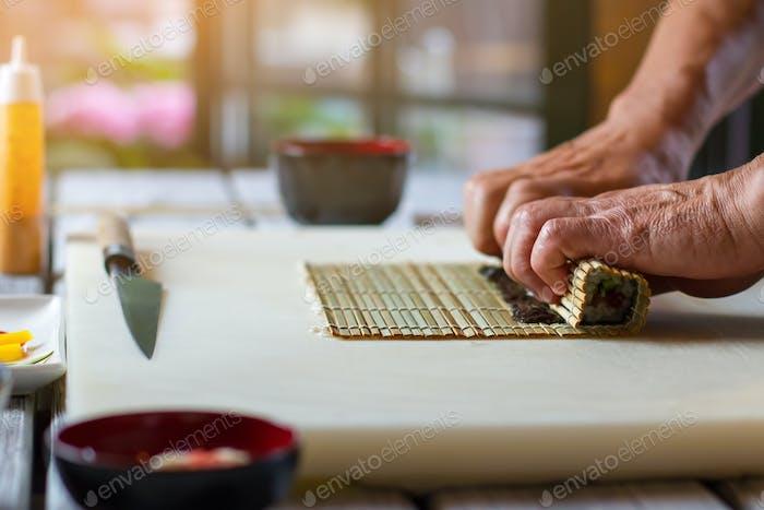 Male hands touching bamboo mat