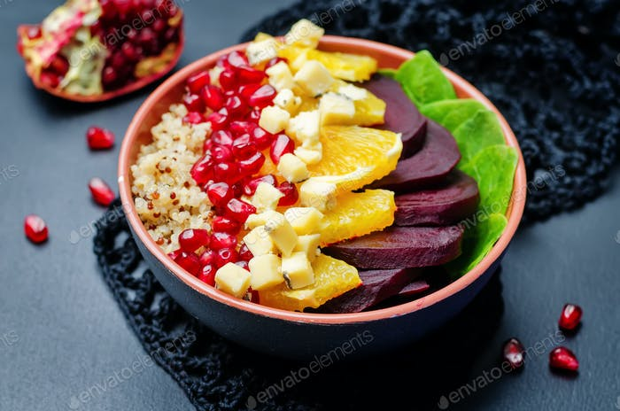 Quinoa spinach beet orange pomegranate blue cheese salad