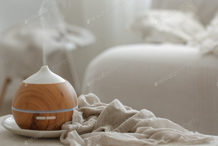 Cozy composition with aroma diffuser for air humidification.