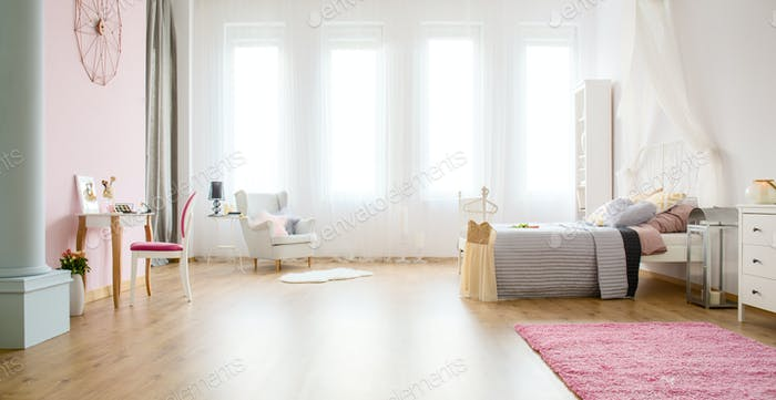 Light bedroom with floor panels