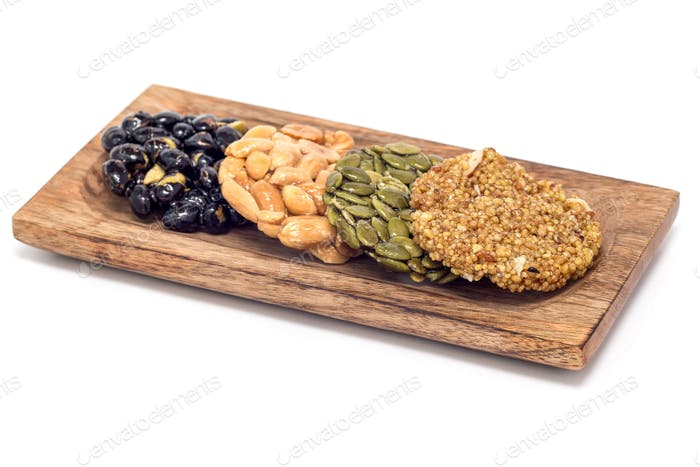 Korean traditional sweet snacks on wooden plate, isolated